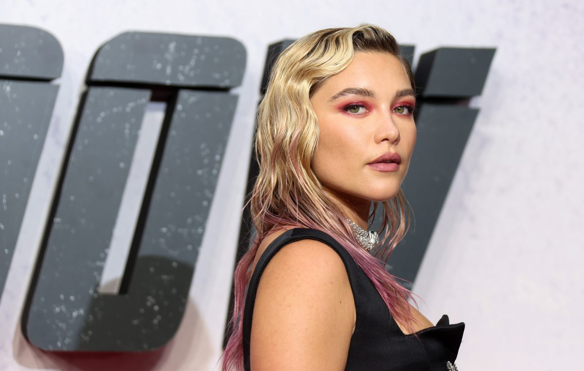 Florence Pugh stands in front of a 'Black Widow' poster at the movie's UK premiere. Pugh played Yelena Belova in 'Black Widow,' marking a huge new phase of her career. And she feared how making the move to the MCU would be received by fans.