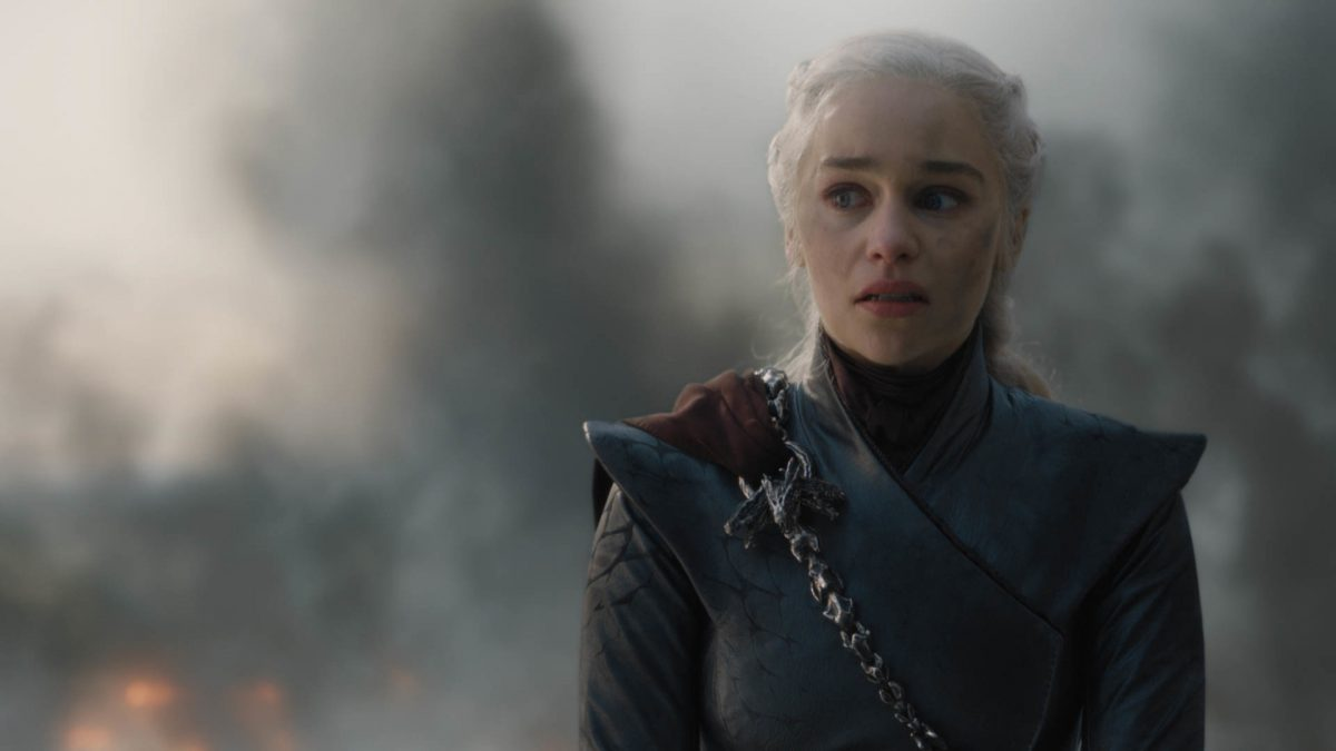 Game of Thrones star Emilia Clarke stands in front of smoking dragon wreckage