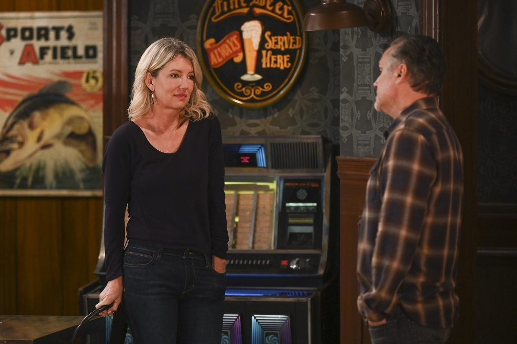 General Hospital speculation focuses on Nina, pictured here in a black shirt with a pair of blue jeans, with a jukebox in the back