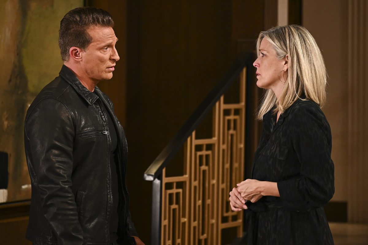 General Hospital speculation focuses on Carly and Jason, pictured here in all black clothing against a wood backdrop