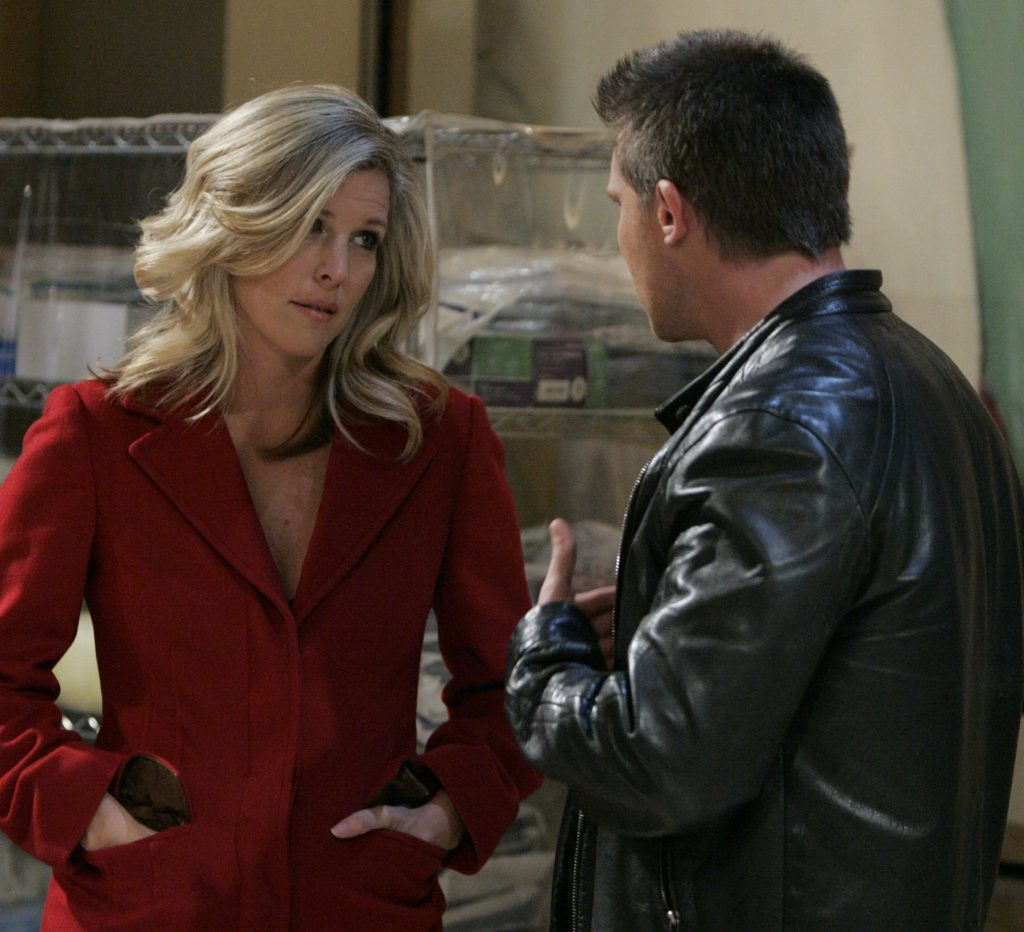 General Hospital speculation focuses on Carly and Jason - Carly is pictured here in a black leather coat against a metal gate