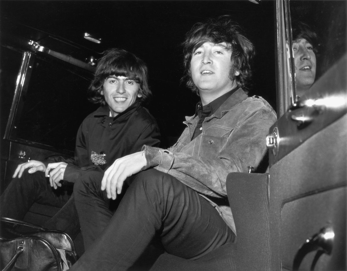 George Harrison and John Lennon at London Airport.