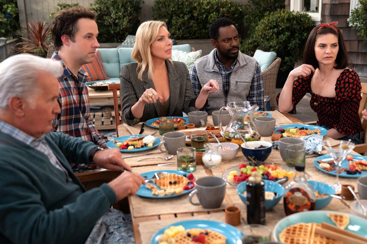 Martin Sheen as Robert, Peter Cambor as Barry, June Raphael as Brianna, Baron Vaughn as Bud and Lindsay Kraft as Allison sit around a table during season 7 of 'Grace and Frankie'