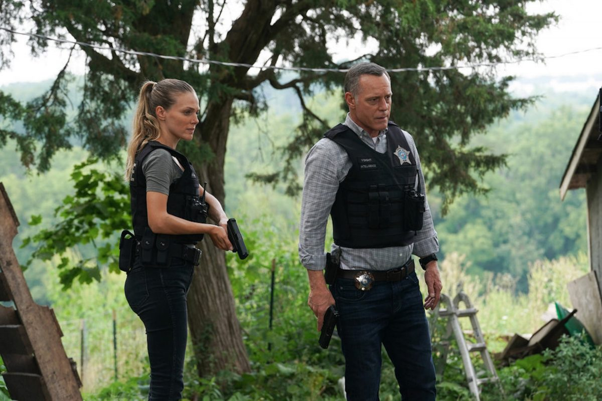 Hailey Upton and Hank Voight standing outside holding guns in 'Chicago P.D.' Season 9