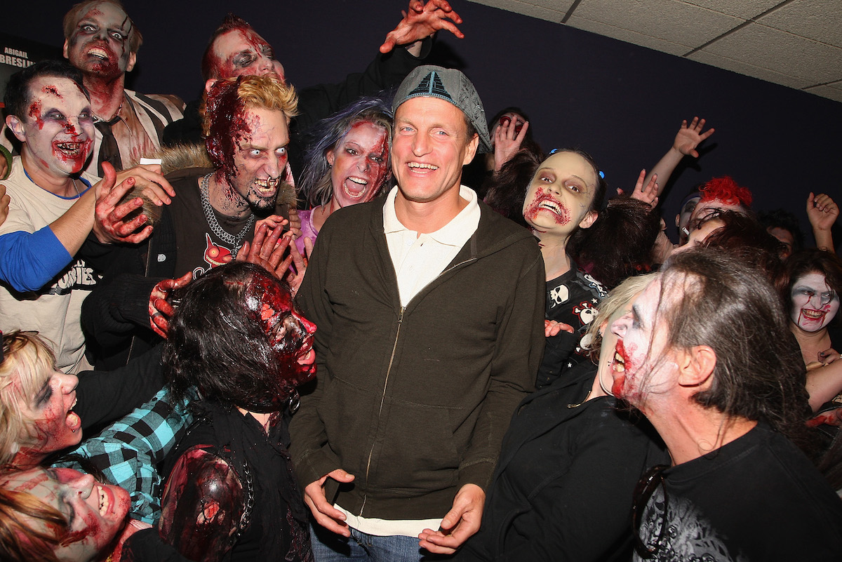 Woody Harrelson with a group of zombies