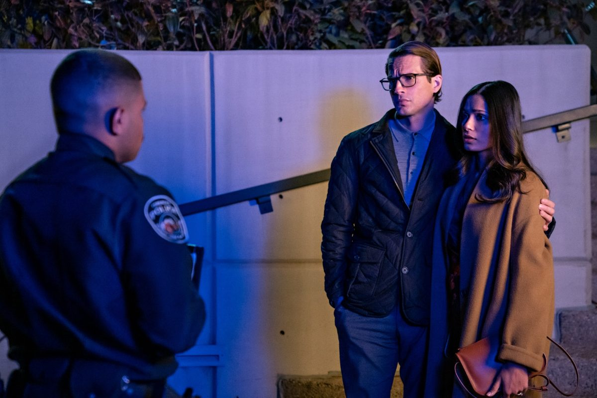'Intrusion' stars Logan Marshall-Green as Henry and Freida Pinto as Meera in the Netflix movie standing outside talking to a police officer