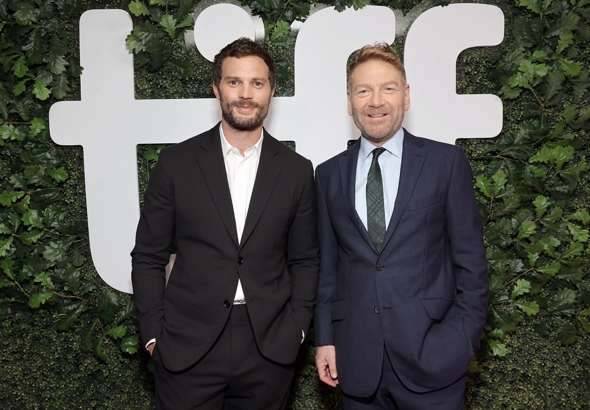 Jamie Dornan and Kenneth Branagh smile at the camera at festival.