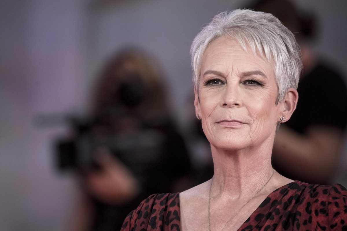 Jamie Lee Curtis smiling for the cameras at the Venice Film Festival to promote her Halloween Kills movie