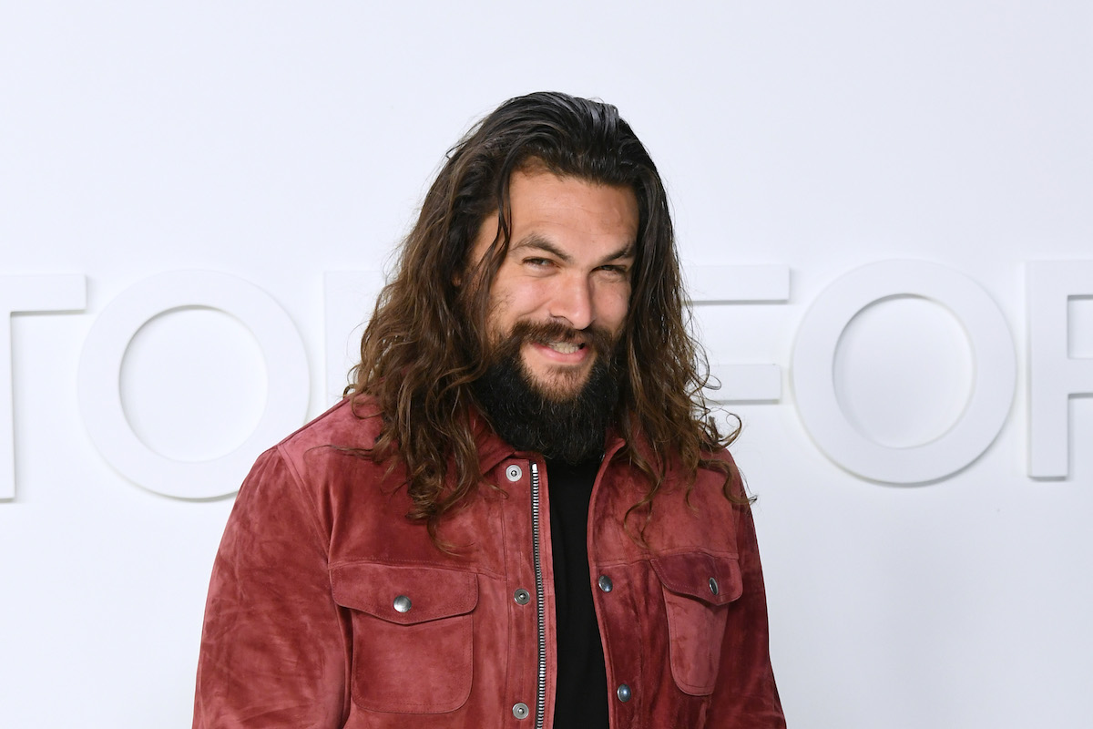 Jason Momoa in a red shirt.