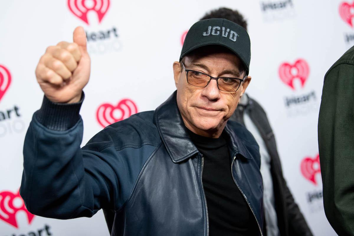 Jean-Claude Van Damme in black ball cap.