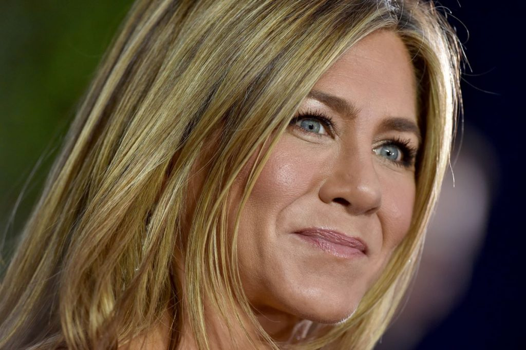 Close up of Jennifer Anniston's face with a blurred background.