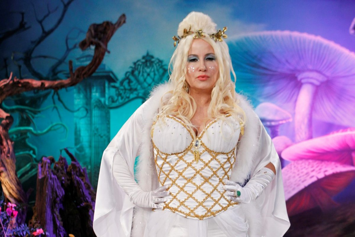 Jennifer Coolidge in a white dress, cape, and crown for Halloween.