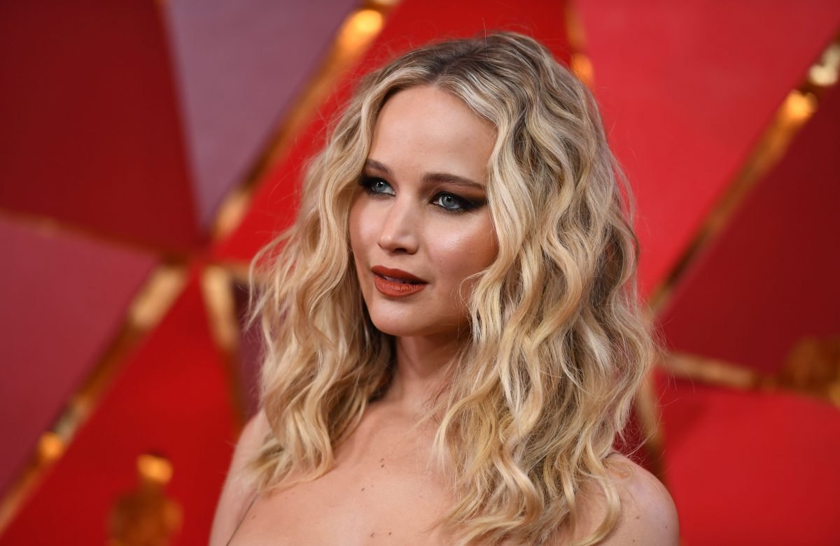 Jennifer Lawrence of 'The Hunger Games' posing at the Oscars