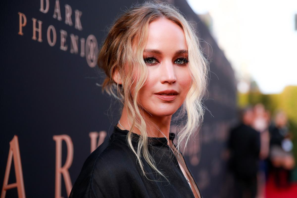 Jennifer Lawrence wears a black dress to a movie premiere