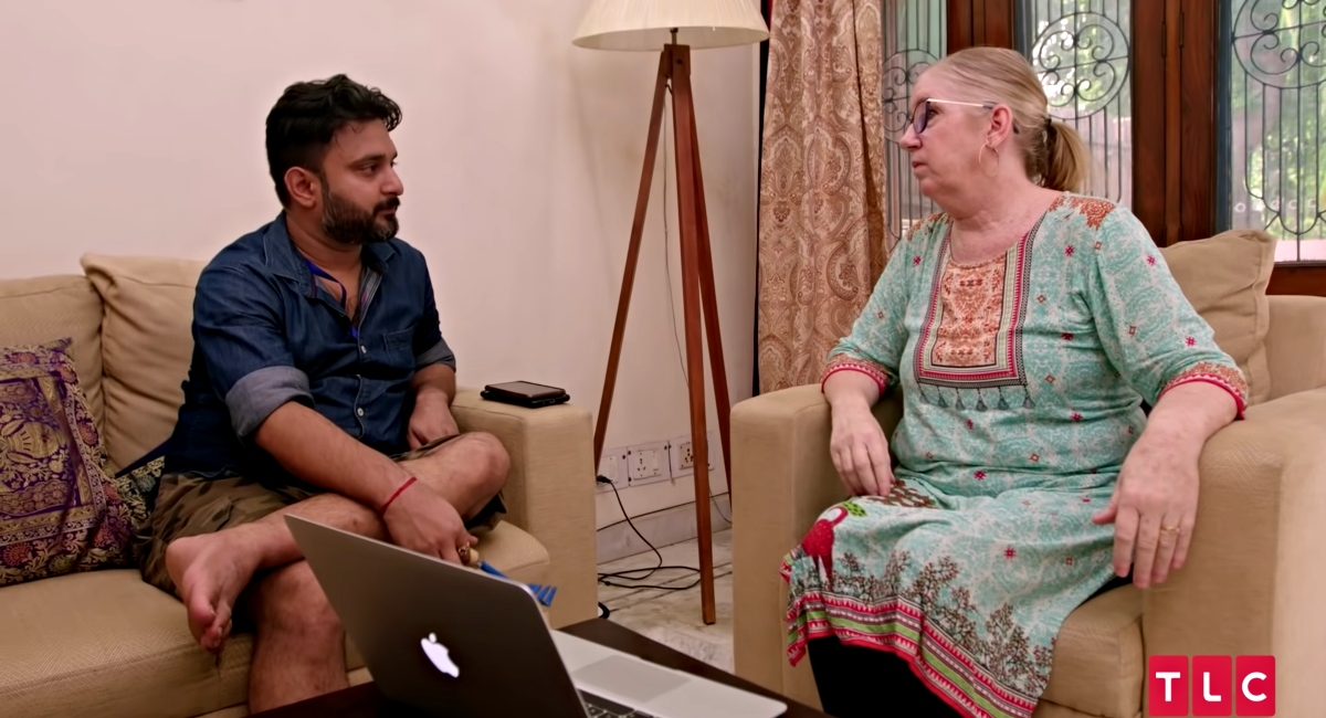 Jenny Slatten and Sumit Singh looking worried, talking in their livingroom in their home in India on '90 Day Fiancé: The Other Way'