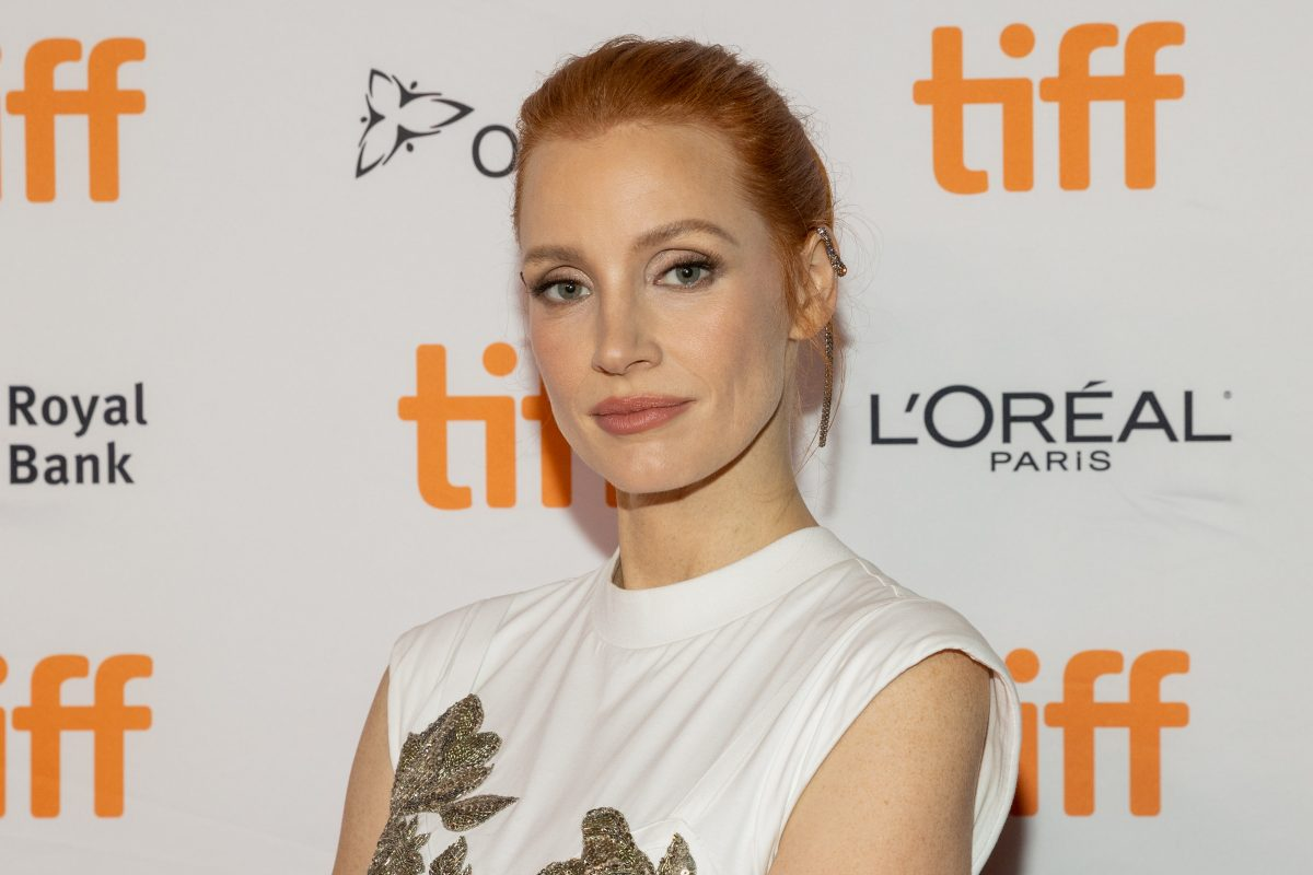 Jessica Chastain, in a white  dress with her hair tied in a bun, at the premiere of her movie 'The Eyes of Tammy Faye' at the Toronto International Film Festival in 2021.