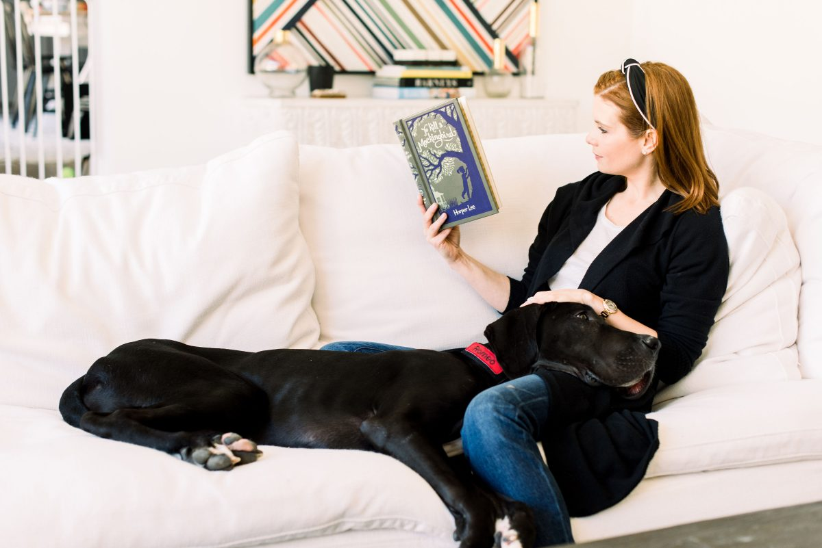 JoAnna Garcia Swisher reads a book with Romeo on her lap