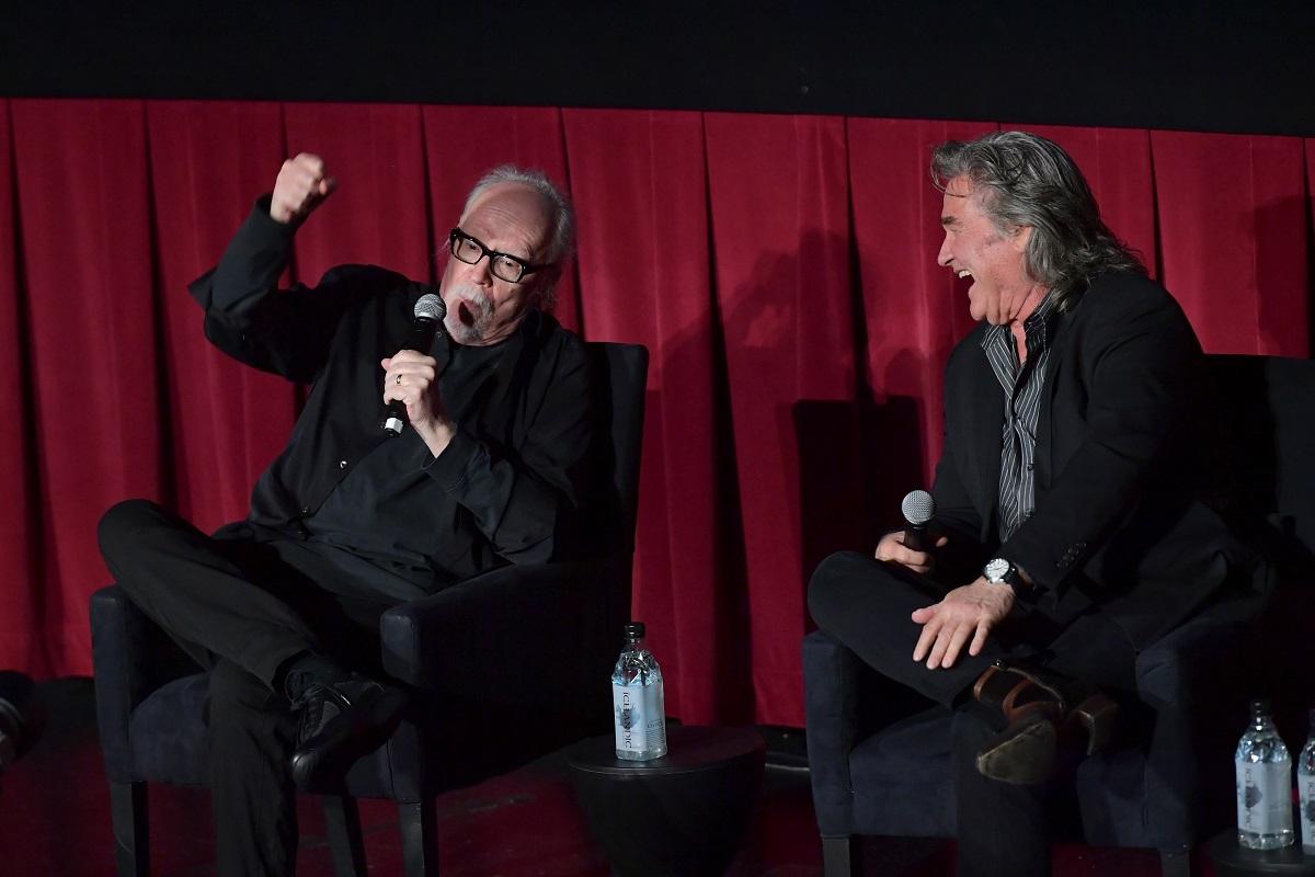 John Carpenter talks while Kurt Russell laughs at a screening.