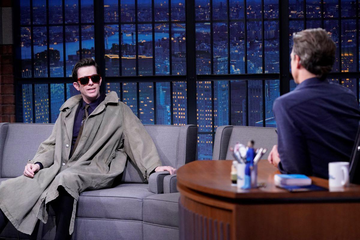John Mulaney wears sunglasses in interview