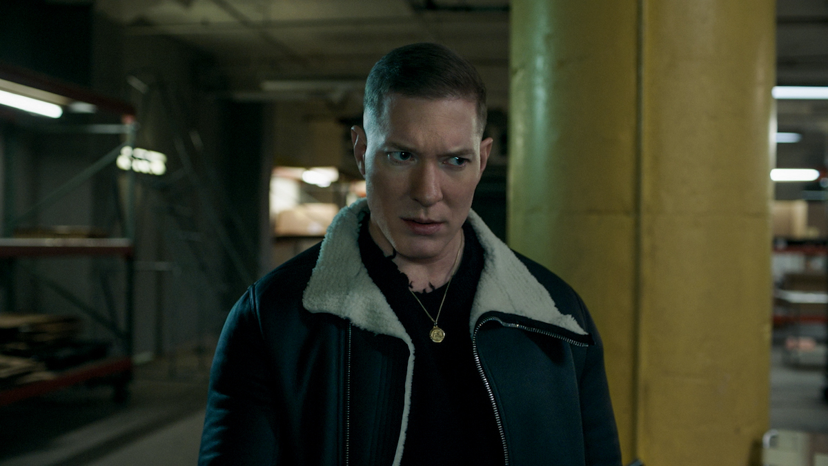 Joseph Sikora as Tommy Egan glaring while wearing a jacket and gold chain in 'Power