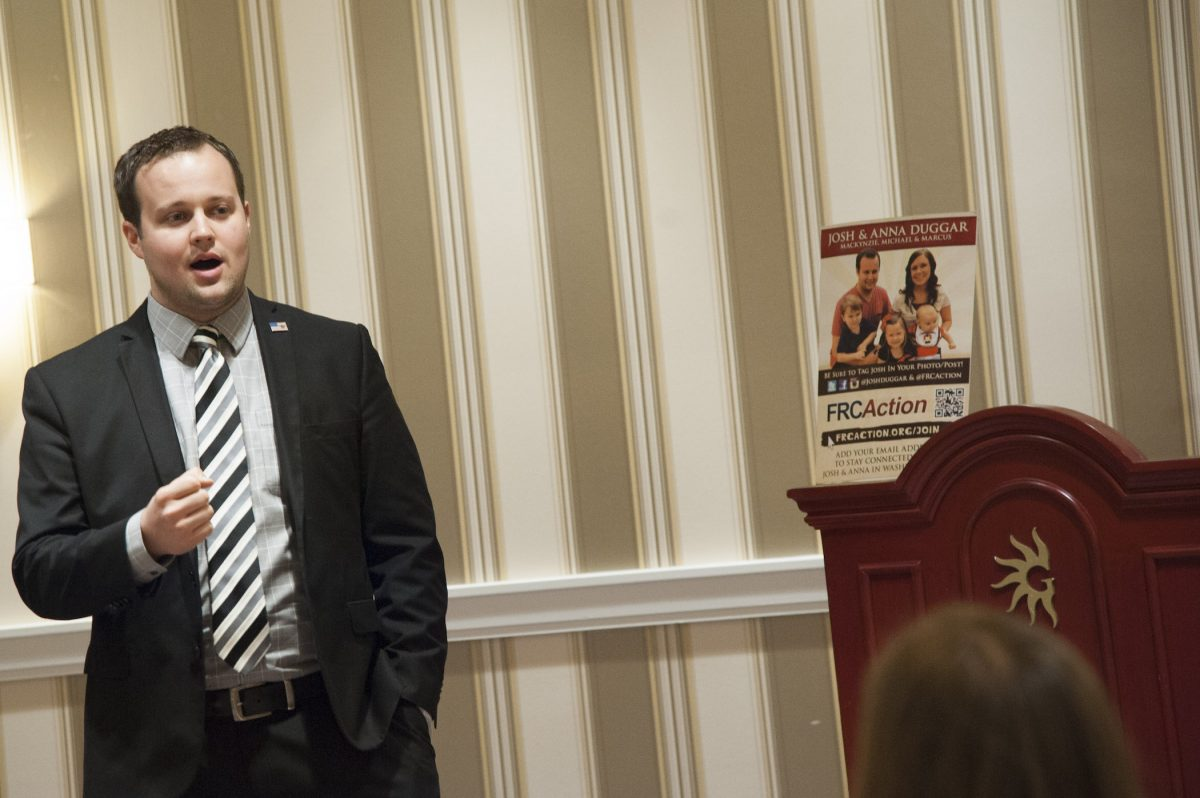 Josh Duggar of the Duggar family speaking at a conference. Josh Duggar's trial for alleged child sexual abuse material is coming in November 2021