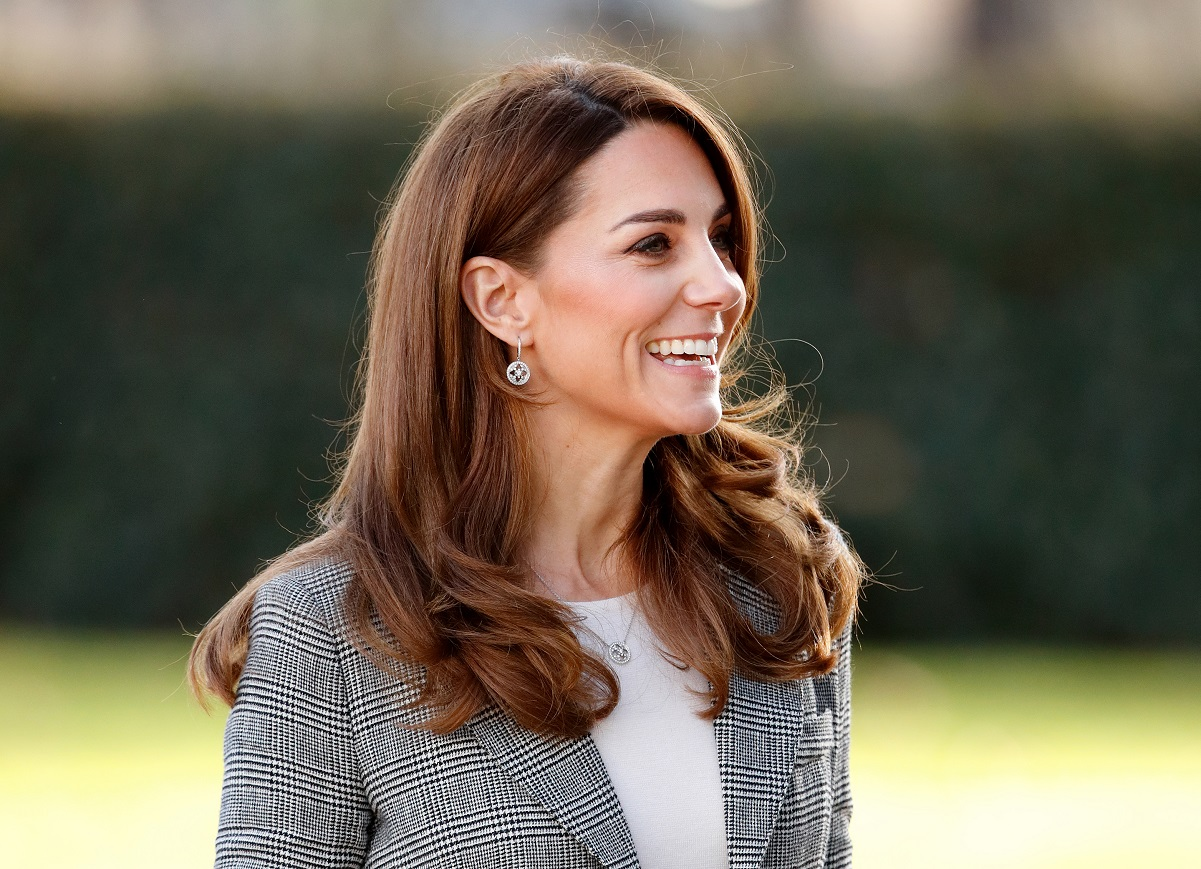Kate Middleton wearing a plaid blazer and white shirt at the Shout's Crisis Volunteer celebration event