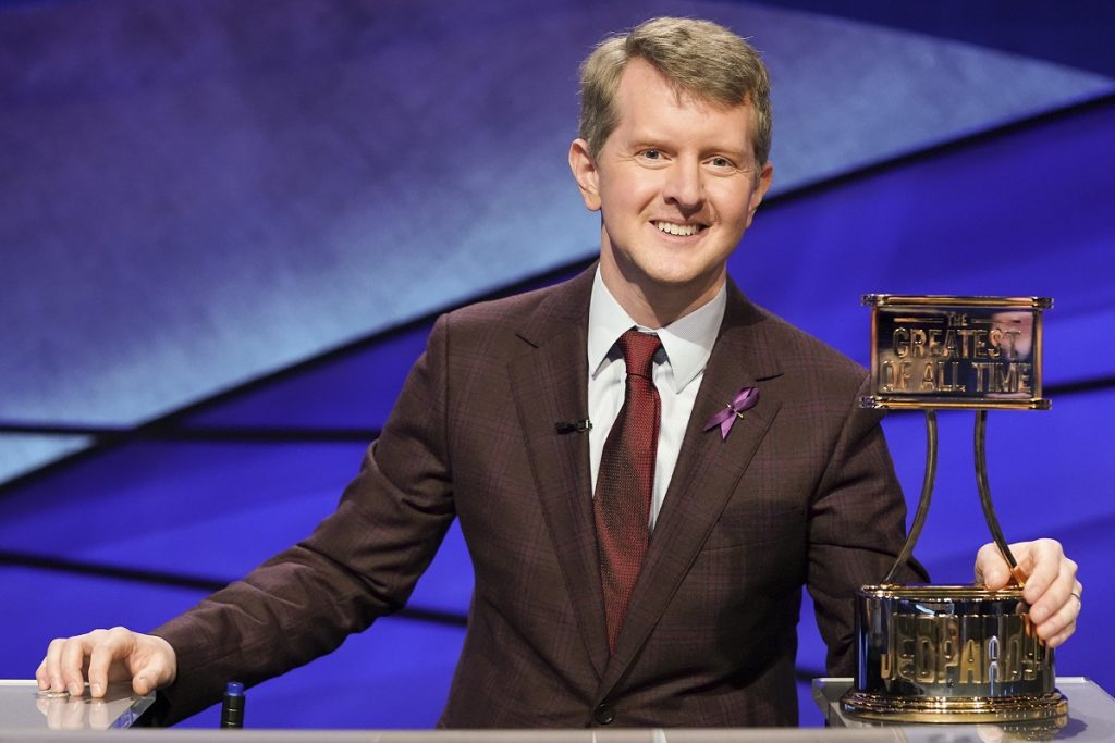'Jeopardy' contestant Ken Jennings poses with his Greatest of All Time trophy during the Tournament of Champions.