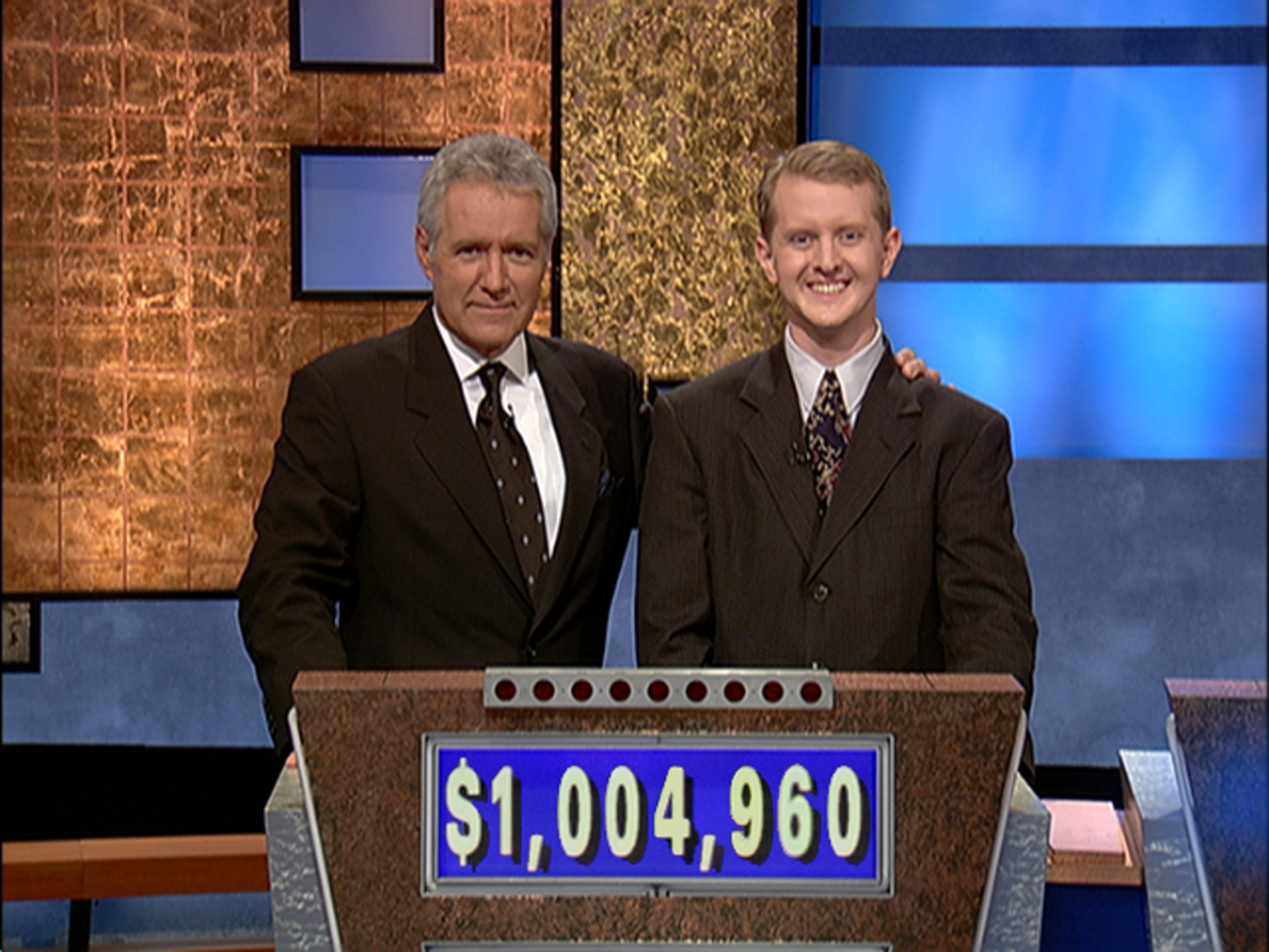 Late 'Jeopardy!' host Alex Trebek and the quiz show's winningest contestant Ken Jennings in 2004.