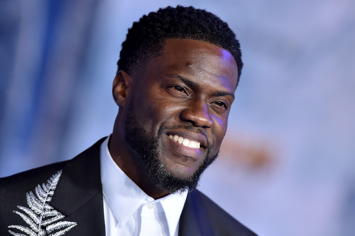 Kevin Hart on the red carpet in a black suit