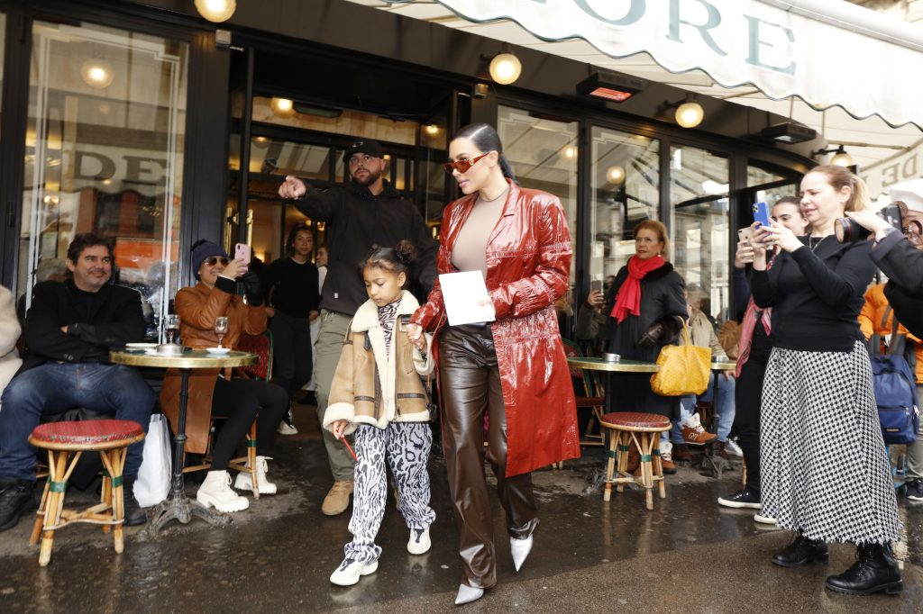 Kim Kardashian and North West walking out of a cafe in Paris