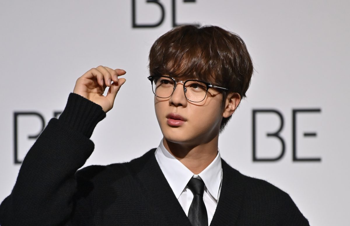 South Korean K-pop boy band BTS member Jin poses for a photo session during a press conference on BTS new album 'BE (Deluxe Edition)'
