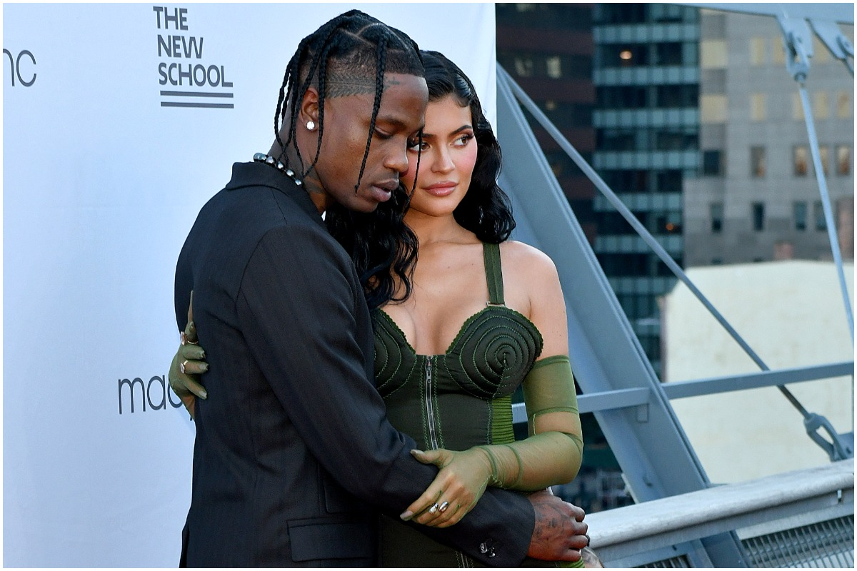 Kylie Jenner and Travis Scott hugging while attending a red carpet event