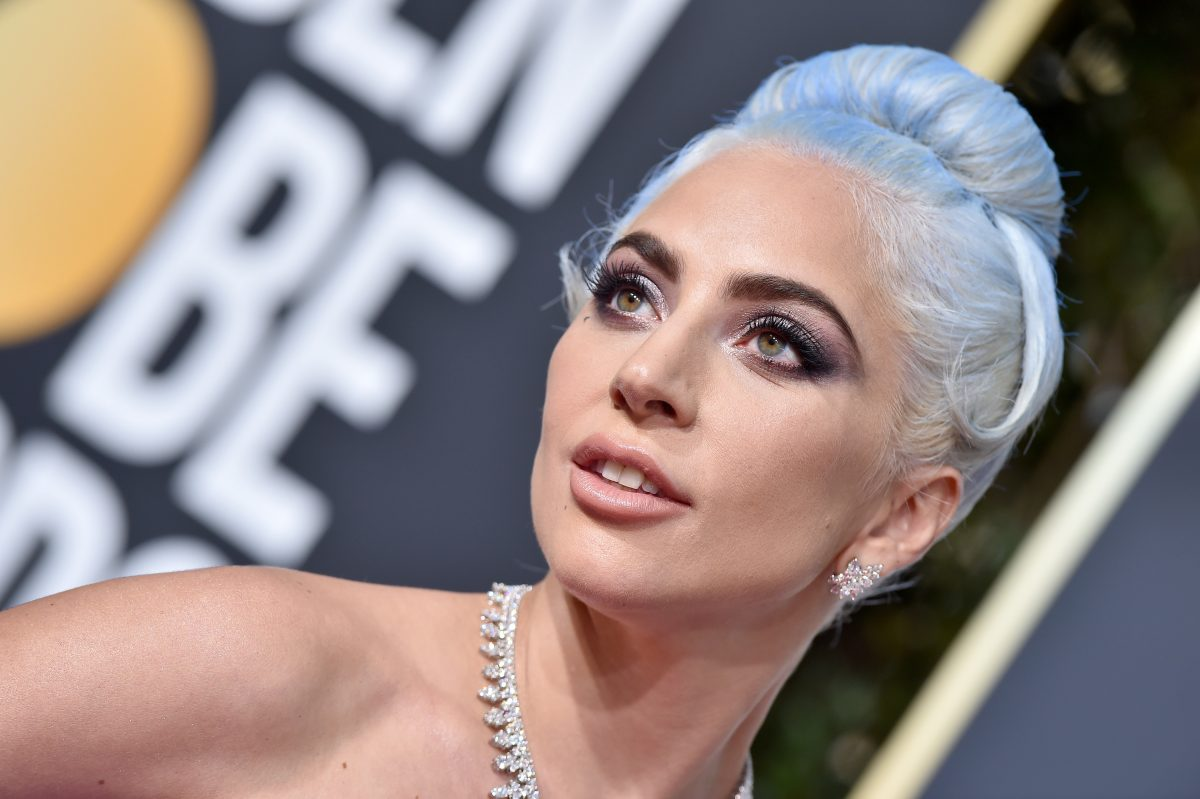 Lady Gaga standing at Golden Globes