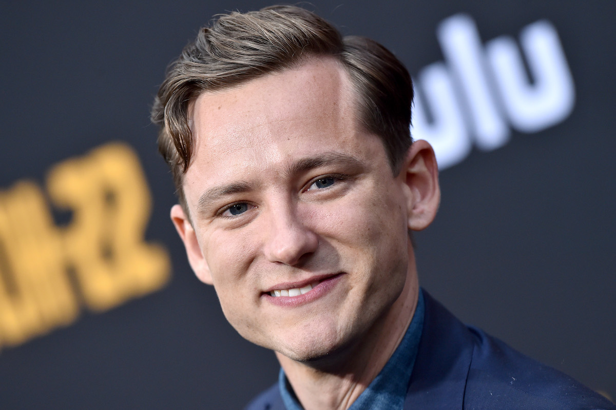 Lewis Pullman giving a smile