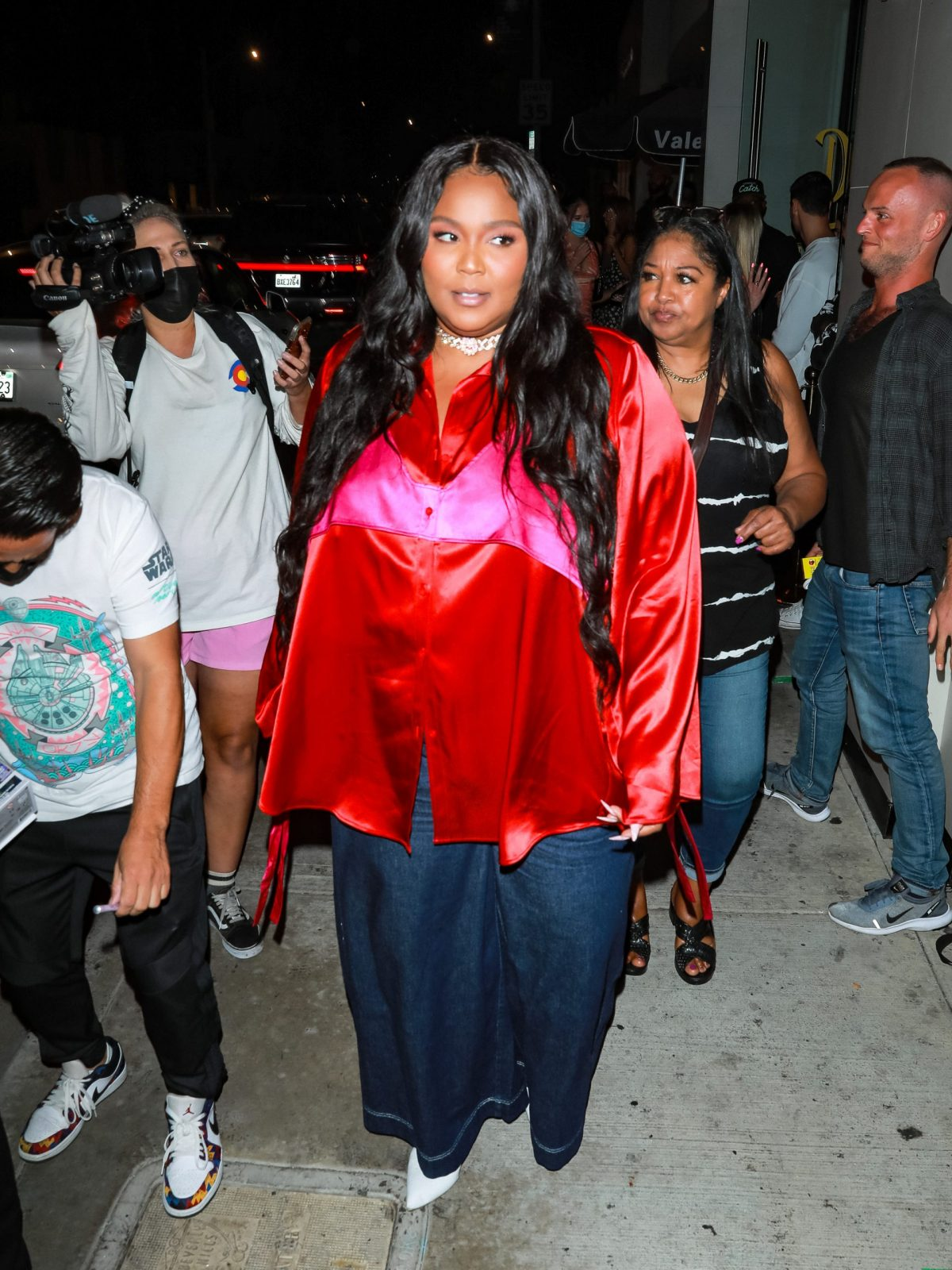 Lizzo in red shirt