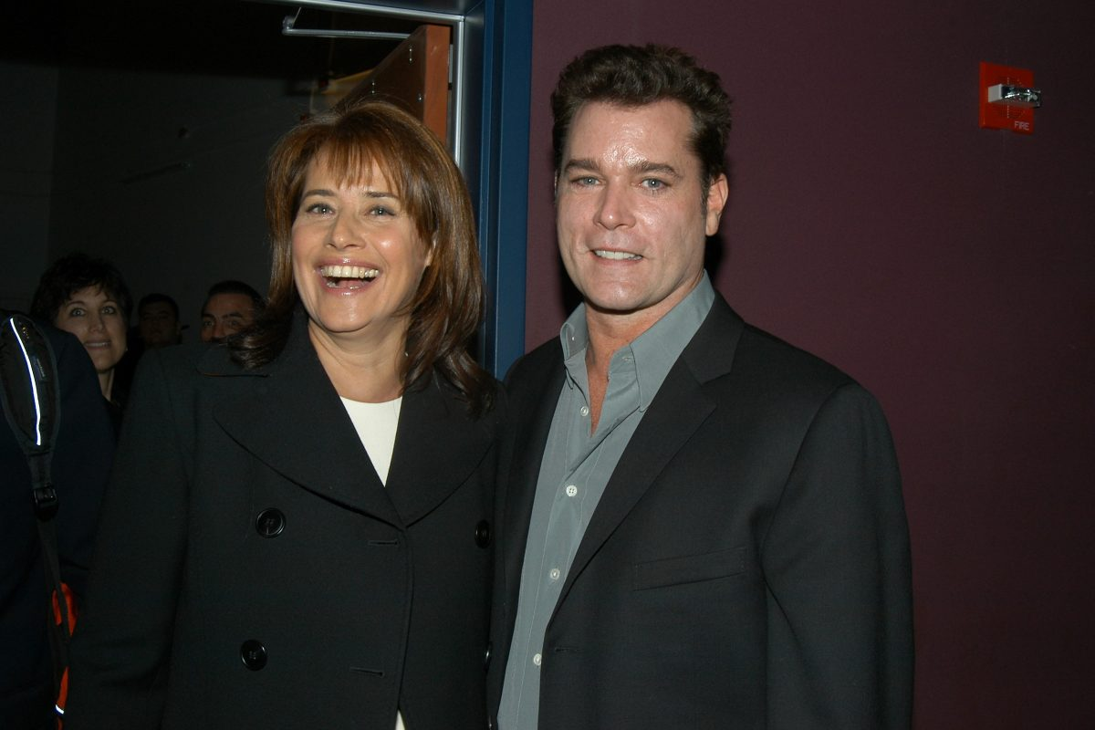 Lorraine Bracco, in a black jacket, and Ray Liotta, in a black suit jacket and grey shirt, at a screening of their movie 'Goodfellas' in 1990.