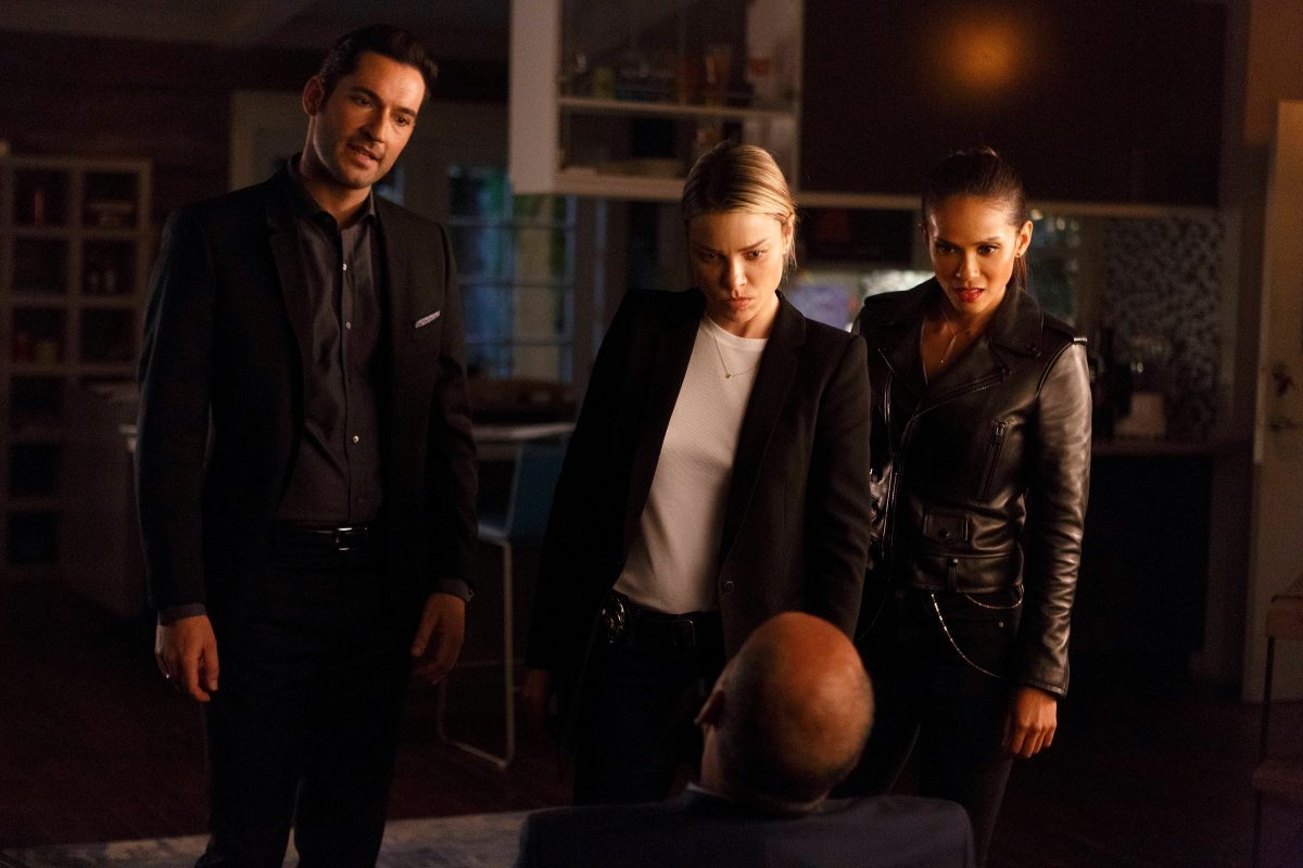 Lucifer, Chloe and Maze of 'Lucifer' looking at a suspect