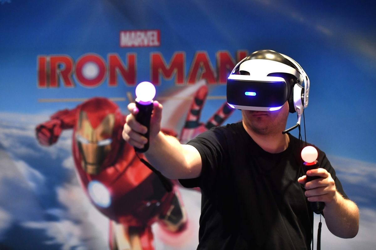 "A visitor plays ""Marvel - Iron Man"" at Playstation stand at Gamescom"