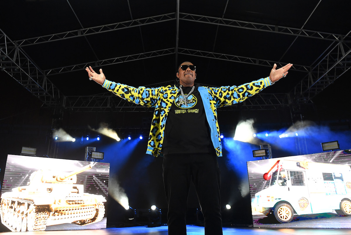 Master P performs in a blue, yellow and black leopard jacket during his No Limit Reunion Tour during 2020 Funkfest at Legion Field on November 07, 2020 in Birmingham, Alabama.
