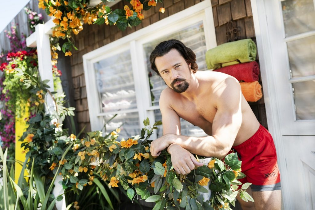 Actor Matthew Atkinson wears red swim trunks during a summer photoshoot for 'The Bold and the Beautiful.'