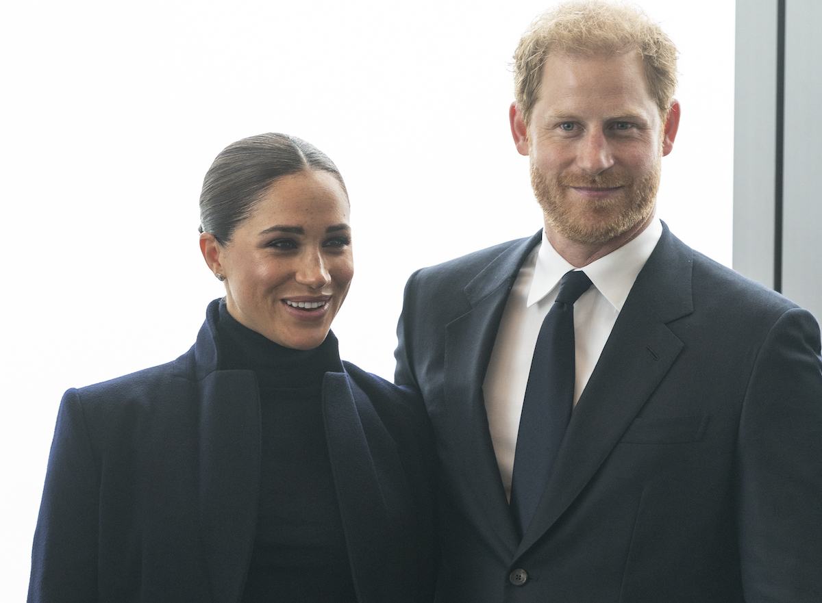 Meghan Markle and Prince Harry smile as they pose for photographs at One World Observatory in September 2021