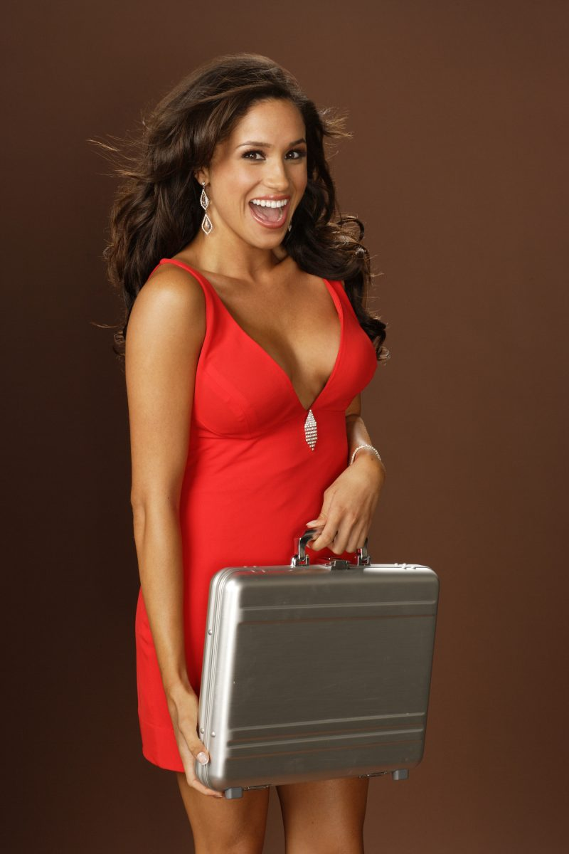Meghan Markle holding a briefcase when she worked on 'Deal or No Deal'
