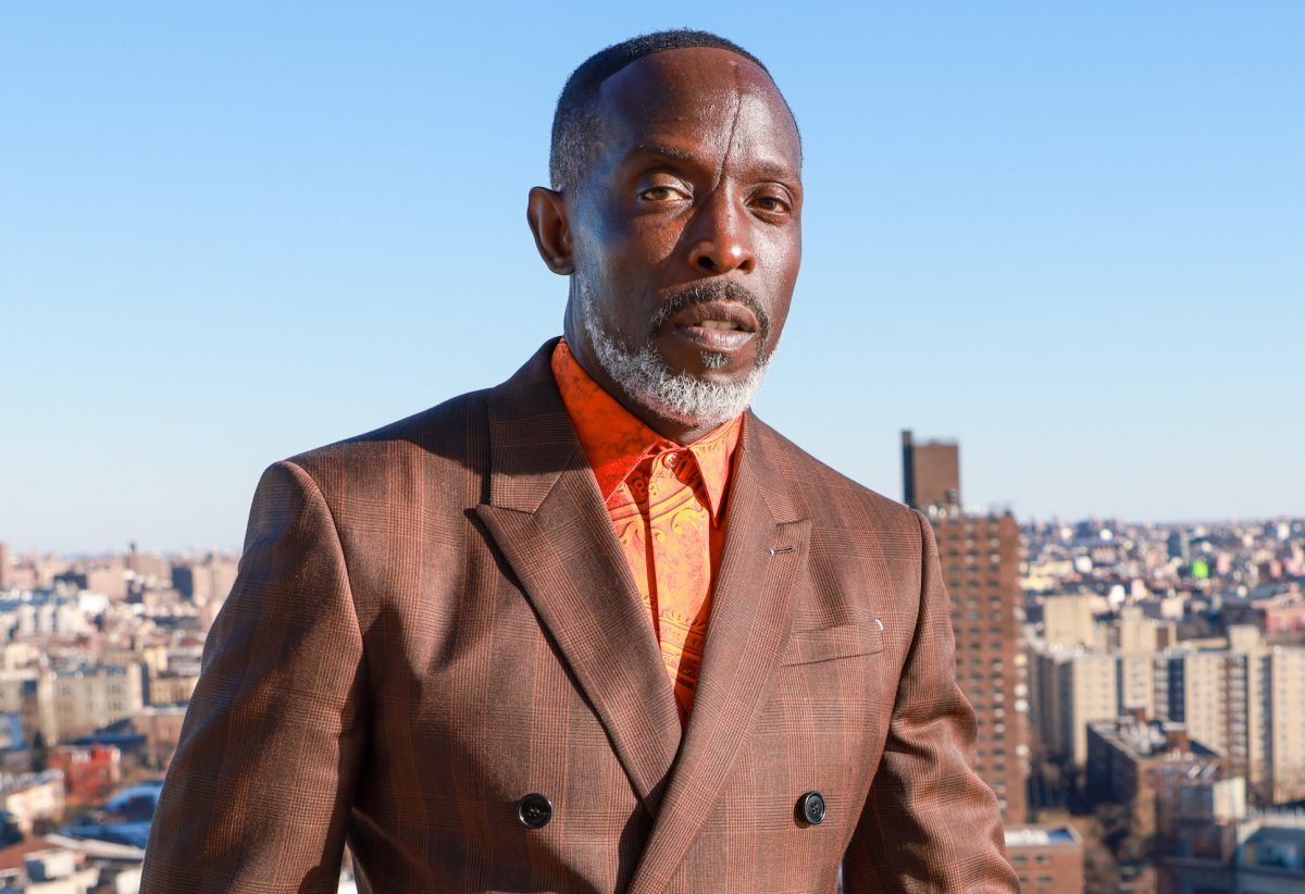 'Lovecraft Country' star Michael K. Williams in a suit against a city backdrop. Michael K. Williams earned his net worth from 'The Wire' and is now nominated for an Emmy thanks to 'Lovecraft Country'