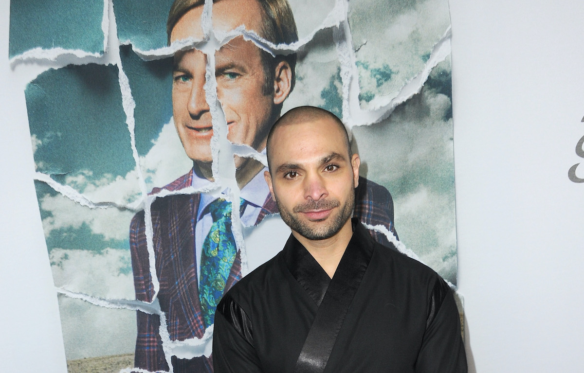 Michael Mando of 'Better Call Saul' wearing a black suit on the red carpet at an event for the show