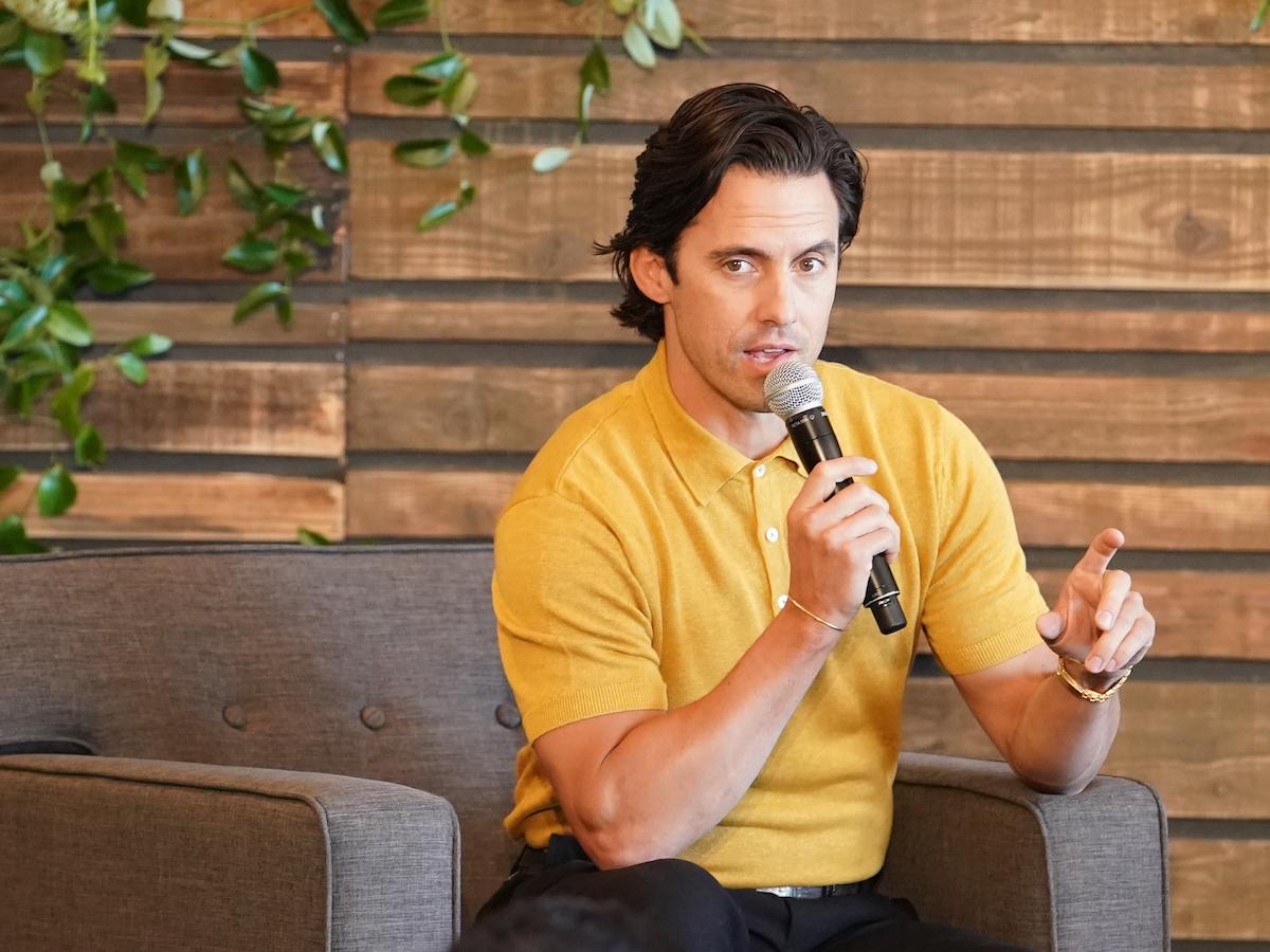 Milo Ventimiglia holding a microphone