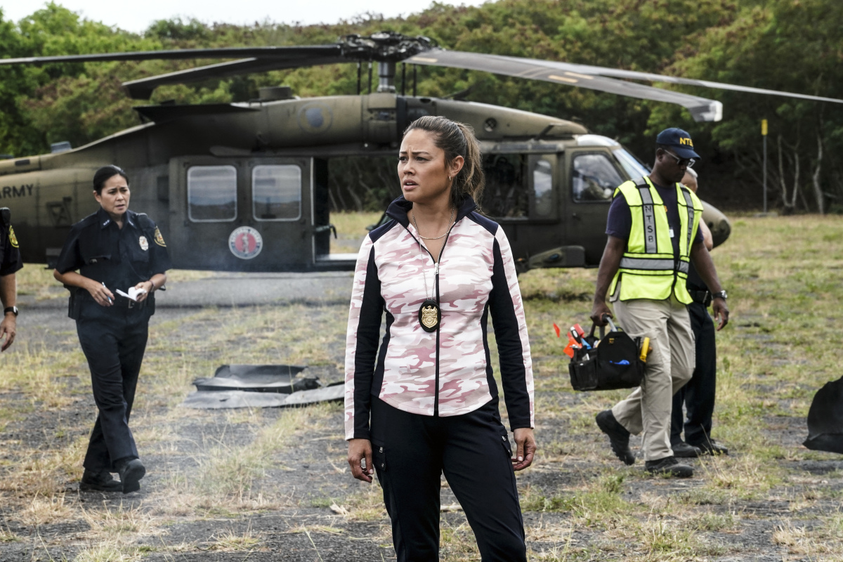 NCIS: Hawai'i -- Vanessa Lachey stands in front of a helicopter