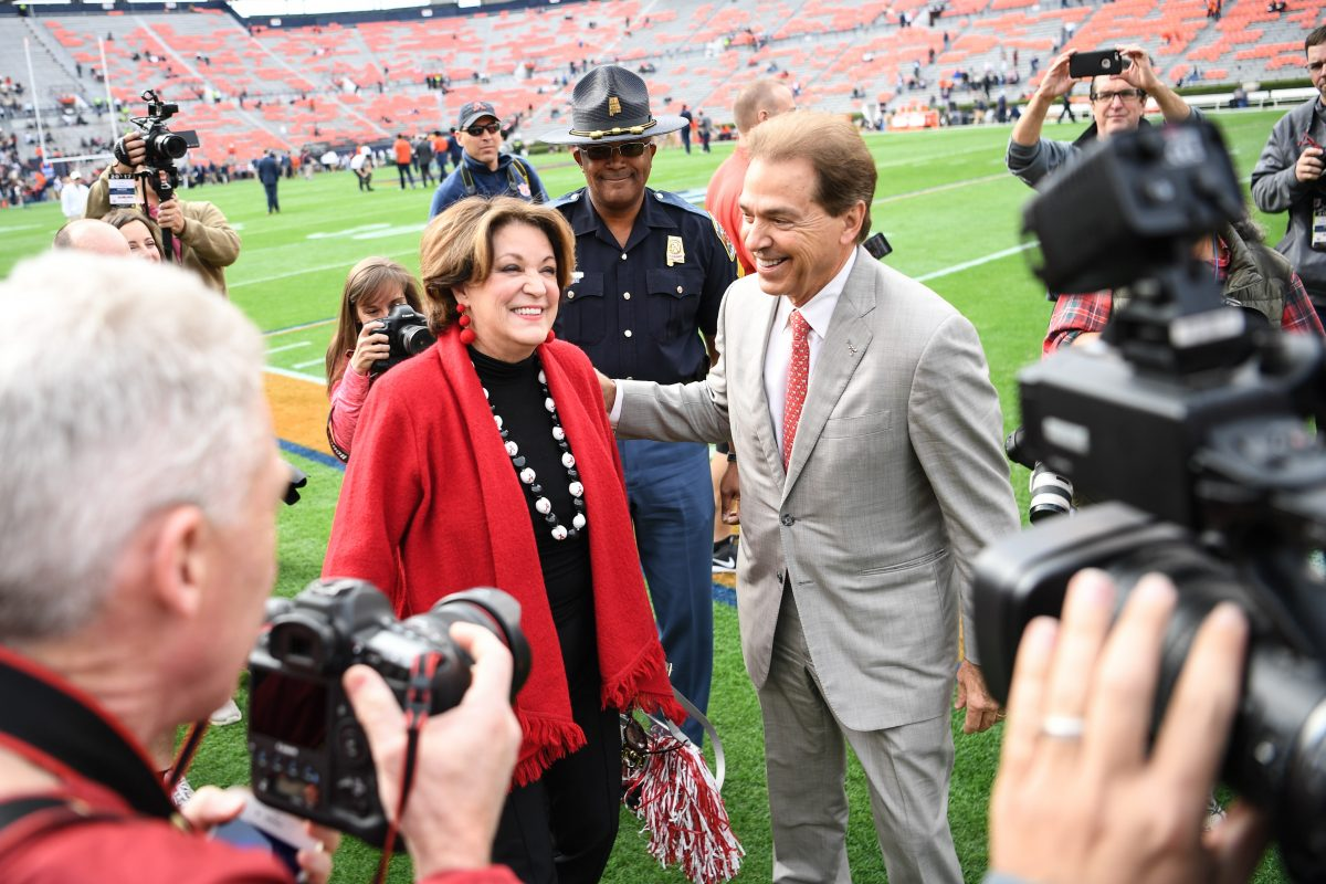 Nick Saban greets wife Terry on the sidelines prior to a football game between the Auburn Tigers and the Alabama Crimson Tide