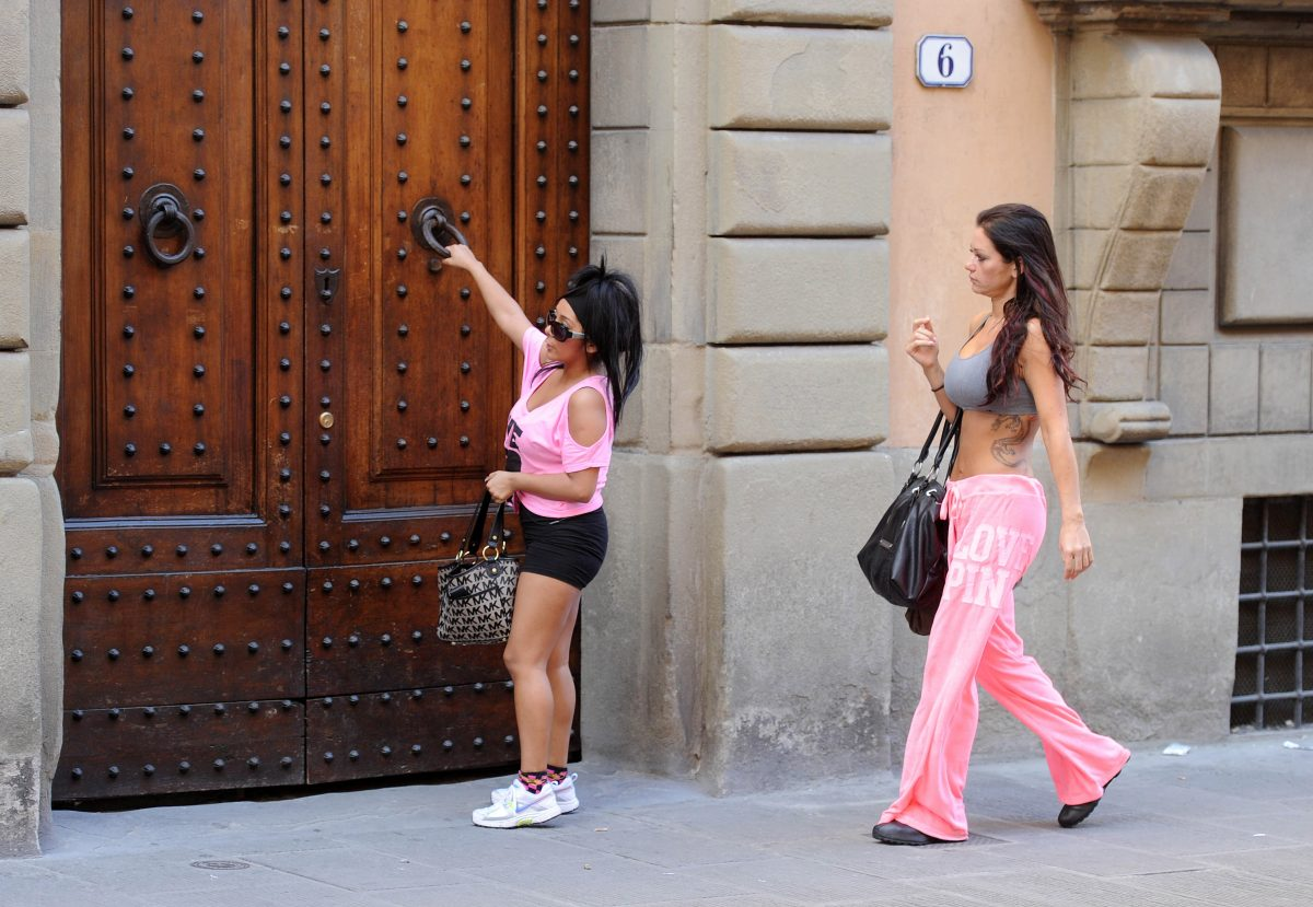 Nicole 'Snooki' Polizzi and Jenni 'JWoww' Farley enter a building in Florence, Italy, where they were filming 'Jersey Shore' Season 4