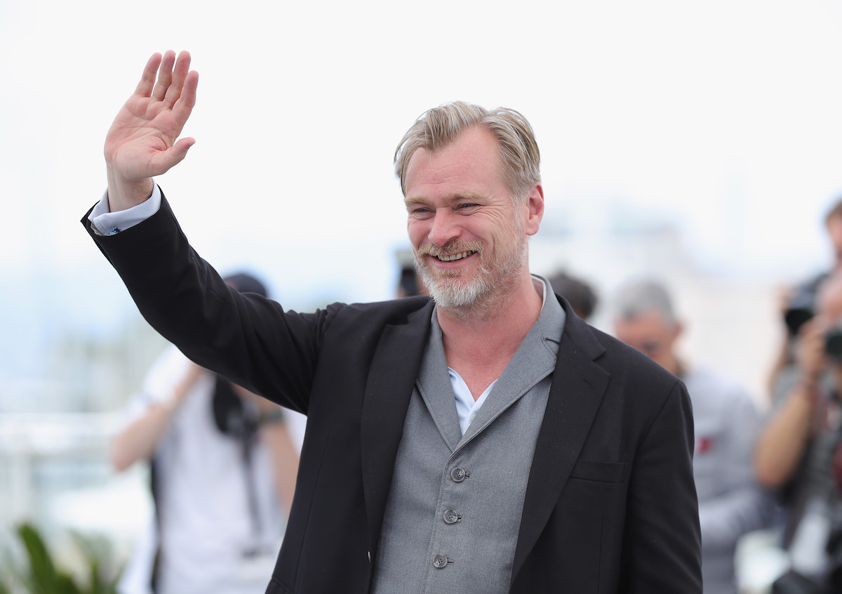 Christopher Nolan waving hello to a crowd