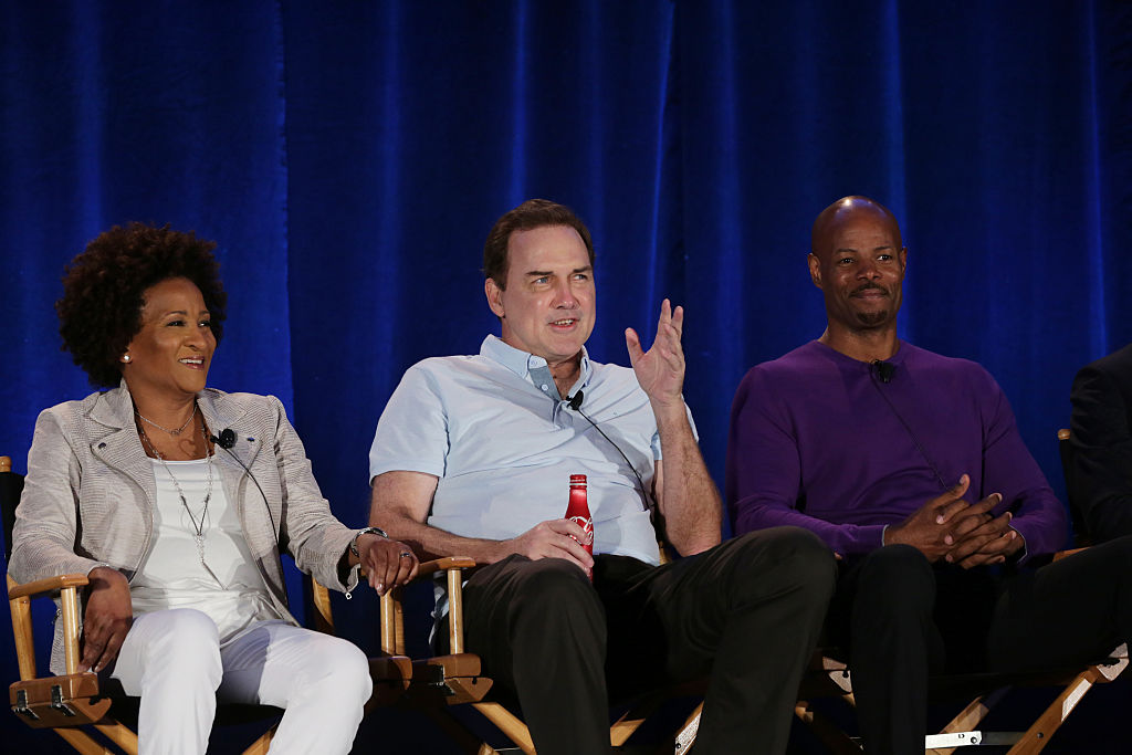 Wanda Sykes, Norm Macdonald, and Keenan Ivory Wayans sit next to each other in chairs while watching auditions.